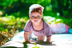 Cute baby crawling in grass Stock Photography