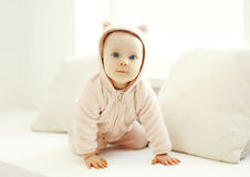 Cute baby crawls in white room home Stock Photography