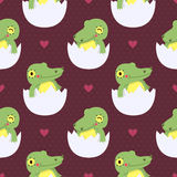 Cute baby crocodile in eggs seamless pattern. With hearts Royalty Free Stock Photo