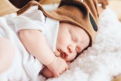 Cute baby in deer hat sleeps Royalty Free Stock Image