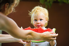 Cute baby with a delicious melon Royalty Free Stock Photo