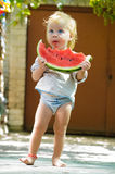 Cute baby with a delicious melon Stock Photo