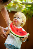 Cute baby with a delicious melon Royalty Free Stock Photos