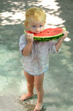 Cute baby with a delicious melon Royalty Free Stock Photography