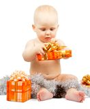 Cute baby develops christmas gift box Stock Photos