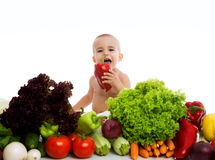 Cute baby with different vegetables Stock Photos