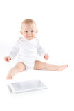 Cute baby with digital tablet Royalty Free Stock Image