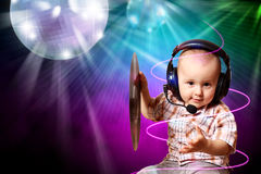Cute baby dj in disco Stock Image