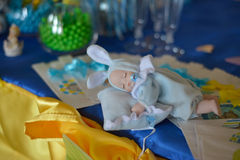 Cute baby doll sleeping Stock Images