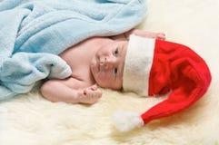 Cute baby dressed as Santa. Royalty Free Stock Photo