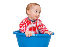 Cute baby dressed and sit in a blue basin Stock Photo