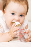 Cute baby drinking water Royalty Free Stock Photos