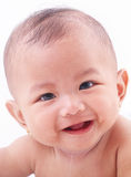 Cute Baby Drooling. Cute baby smiling and drooling over white background Stock Photos