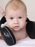 Cute baby with earphones Royalty Free Stock Photo