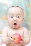 Cute Baby Eat Apple Stock Images