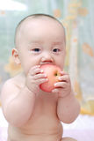 Cute baby eat apple Royalty Free Stock Photography