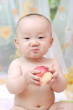 Cute baby eat apple Royalty Free Stock Images