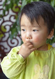 A cute baby is eating Royalty Free Stock Images
