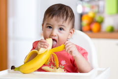 Cute baby eating banana Royalty Free Stock Photos