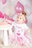 Cute baby eating the birthday cake Royalty Free Stock Photos