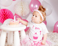 Cute baby eating the birthday cake Royalty Free Stock Image