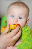 Cute baby eating healthy food Royalty Free Stock Photography