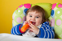 Baby boy eating carrot Stock Photography