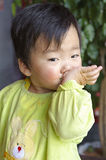 A cute baby is eating in restaurant Stock Photo