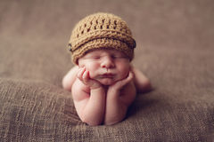 Cute baby on elbows Stock Photography