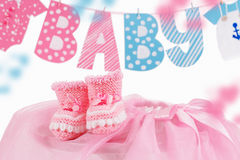 Cute baby element with word baby and pink bootees Royalty Free Stock Photo