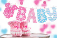 Cute baby element with word baby and pink bootees Stock Photos
