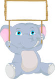 Cute baby elephant cartoon with blank sign Stock Images