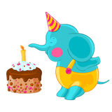 Cute baby elephant in hat and pants blow out the candle on the birthday cake. Royalty Free Stock Images