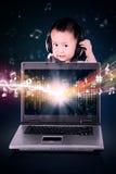 Cute baby enjoying music Stock Photography