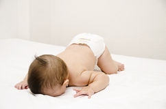 Cute baby face down. Face down lying baby on bed Royalty Free Stock Photo