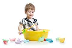 Cute baby fishing and sitting inside washbowl Stock Image