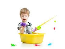 Cute baby fishing and sitting inside washbowl Royalty Free Stock Image