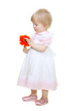 Cute baby with flower gerbera Stock Photos
