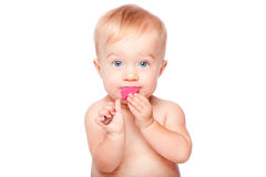 Cute baby with food spoon in mouth. Cute adorable infant baby with food spoon in mouth eating and blue eyes, isolated stock images