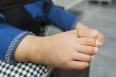Cute baby foot stock photos