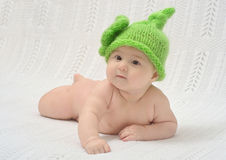Cute baby in funny green hat Royalty Free Stock Photos