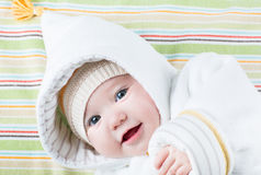 Cute baby in a funny hat on a colorful blanket Royalty Free Stock Image