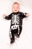 Cute baby in funny skeleton suit Royalty Free Stock Photos