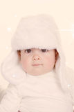 Cute baby in furry hat Royalty Free Stock Photos