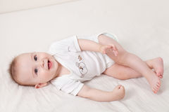 Cute baby giggles Royalty Free Stock Photo
