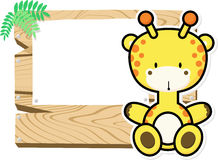 Cute baby giraffe on wooden board Royalty Free Stock Images