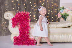 Free Cute Baby Girl 1-2 Year Old Sitting On Floor With Pink Balloons In Room Over White. Isolated. Birthday Party. Celebration. Happy B Stock Images - 91798794