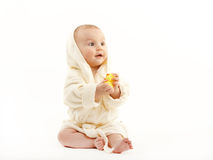 Cute baby girl. Little cute baby girl in yellow bathrobe isolated on white Stock Photo