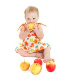 Cute baby girl with apples Stock Images