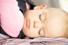 Cute baby girl asleep Stock Photos